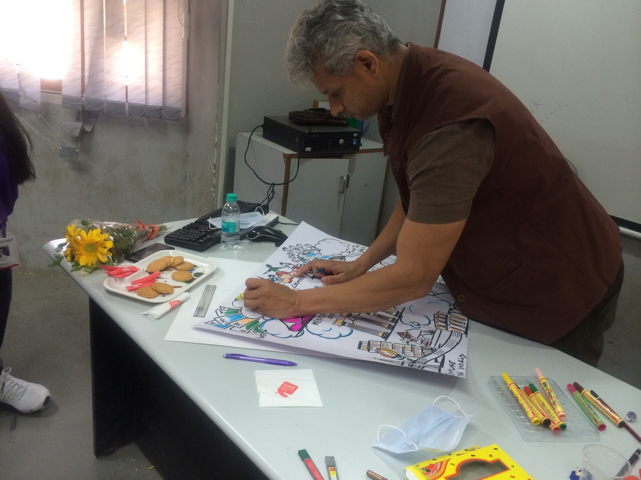 JUDGING THE POSTER MAKING COMPETITION AT B K  SCHOOL OF
